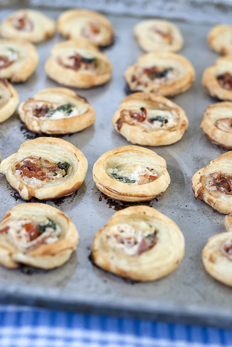 Creamy mozzarella and salty prosciutto pinwheels with whole ground mustard and fresh spinach make the perfect tasty and easy holiday hors d'oeuvres!