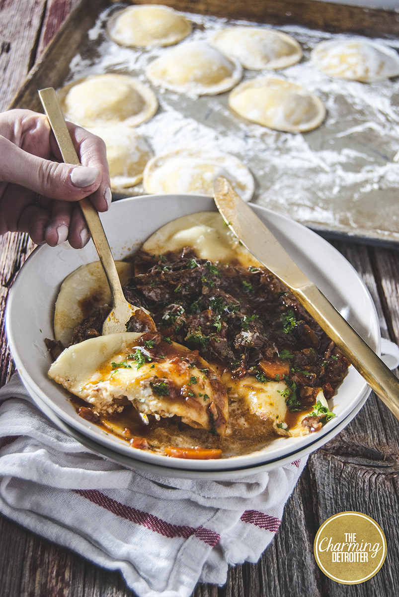 This short rib bolognese will be your new favorite slow-roasted dish! This short rib bolognese is paired with creamy ricotta ravioli.