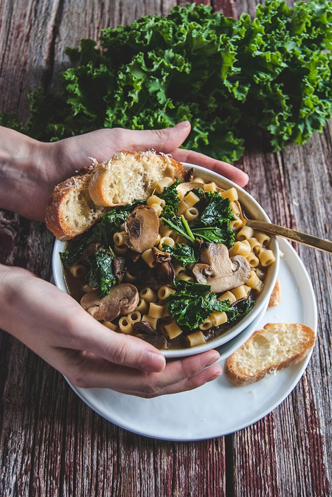 This hearty whiskey parmesan soup features ditalini noodles, fresh kale and sautéed mushrooms in a wholesome whiskey and parmesan rind broth.