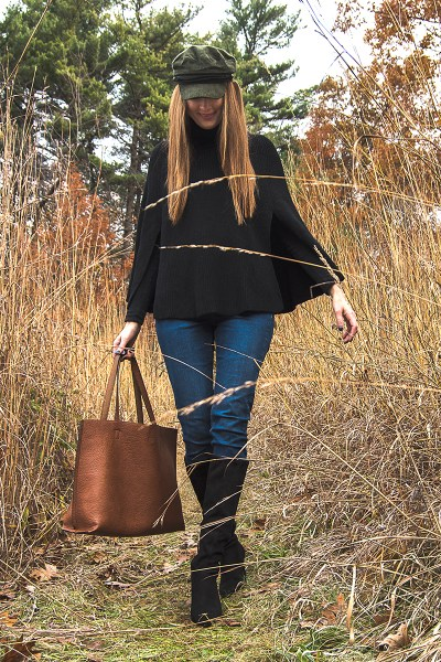 This black sweater cape is the perfect accessory for staying warm this season! Add suede boots and your favorite hat, and it's the perfect winter weekend look!