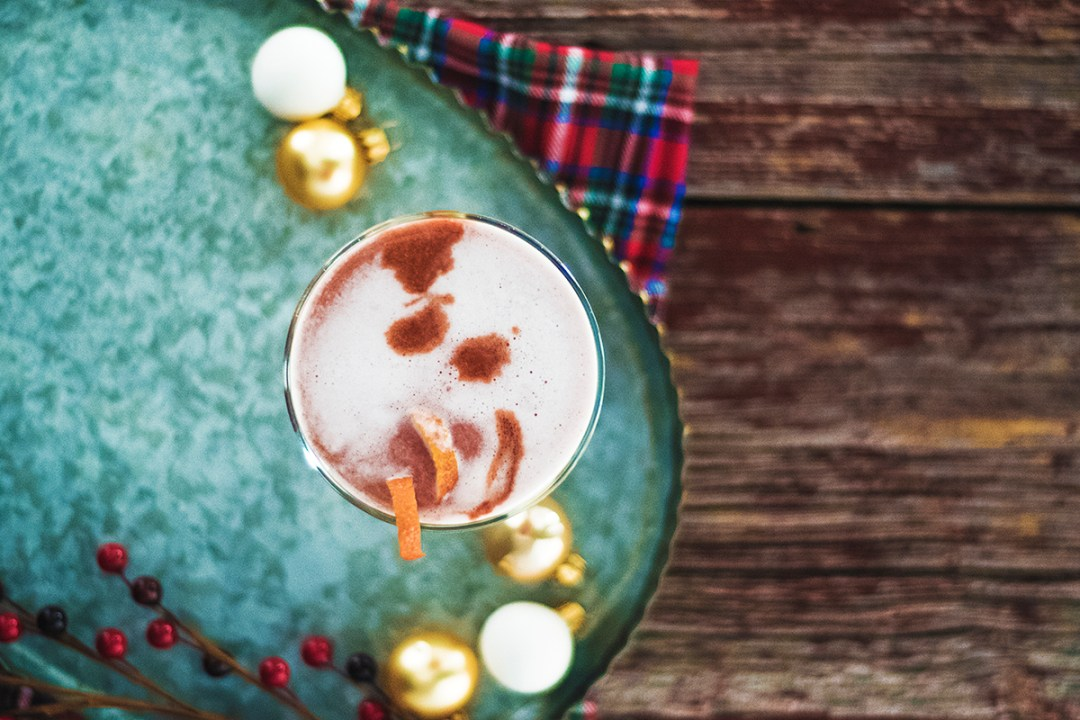 My earl grey gin fizz is the perfect classy cocktail for the holidays! It features a unique homemade earl grey honey simple syrup that you're going to love!