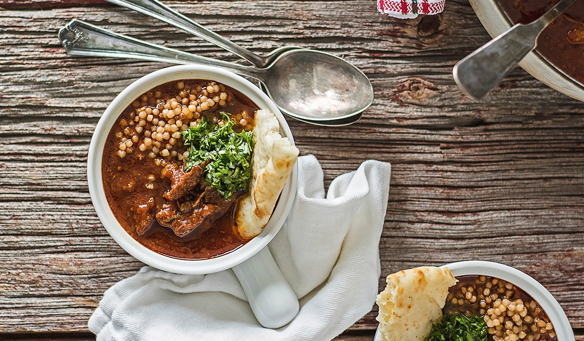 These Moroccan shortribs are smothered in tasty spices and tomato sauce, and are paired with Israeli couscous and a fresh cilantro and parsley herb sauce.