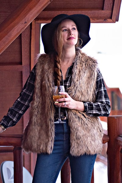 This faux fur vest outfit is the perfect winter look for all this cold, snowy weather we've been having lately! Paired with denim, plaid, and a cozy hat.