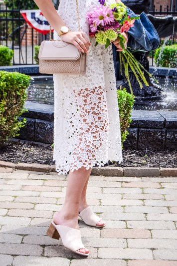 This white lace midi dress is the perfect summer wardrobe staple for all your warm weather events! It comes in so many fantastic colors too, and is on sale now!