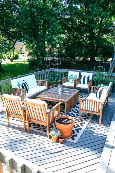 We painted our deck! It took forever, but it was worth it. Now check out the before and after and my step-by-step guide for this modern farmhouse deck reveal!