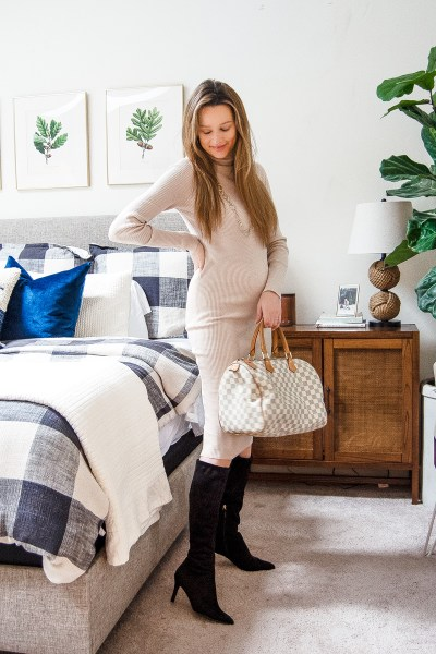 This ribbed turtleneck midi fall sweater dress is the perfect piece for your winter wardrobe, and fits in just as perfectly for a work look as it does for a weekend look!