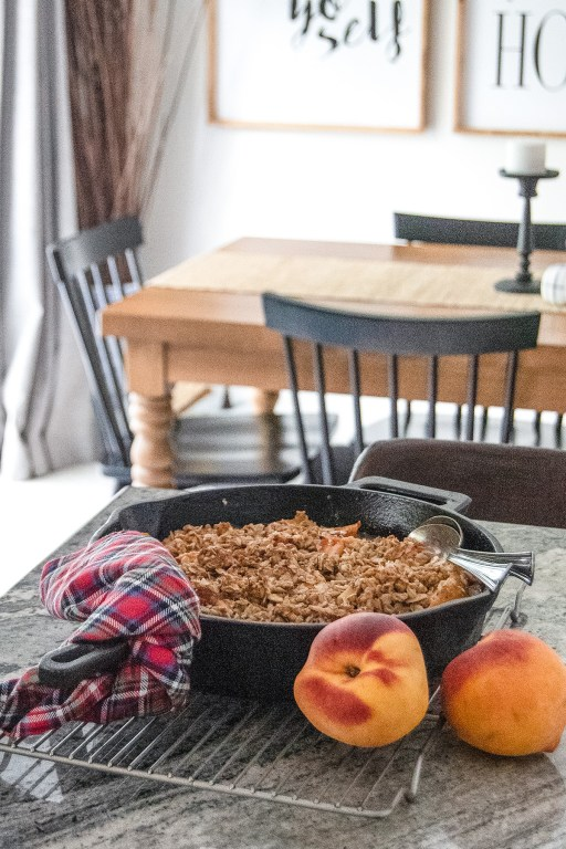 This bourbon peach crumble is super tasty with a delicious crumbly oat topping and fresh homemade whipped cream, and comes together in under an hour!