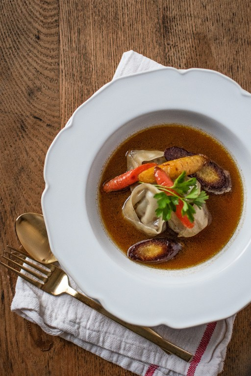 I'm keeping y'all warm this winter with these comforting and tasty beef brisket dumplings, served with sautéed carrots and a rich Asian-inspired bone broth!
