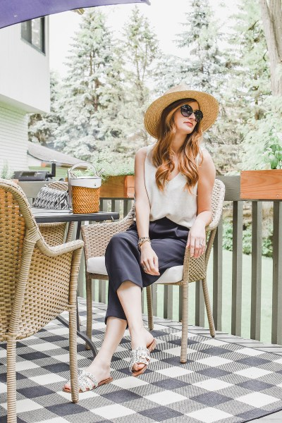 Summer meets the most perfect pair of chic black pants in this classic color combo, complete with straw accessories!