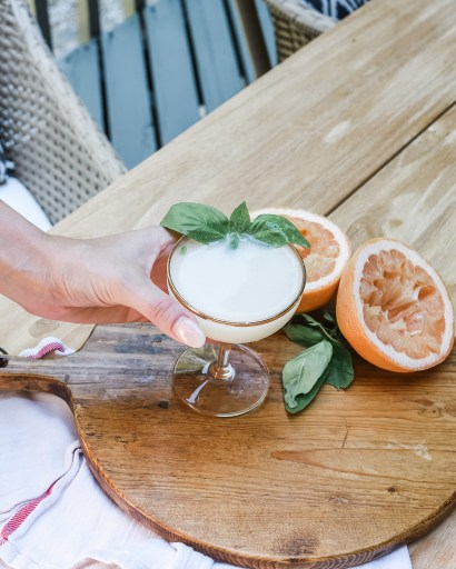 This gin and coconut milk cocktail is a party for the senses! The perfect drink for late summer, it features honey simple syrup and grapefruit juice.