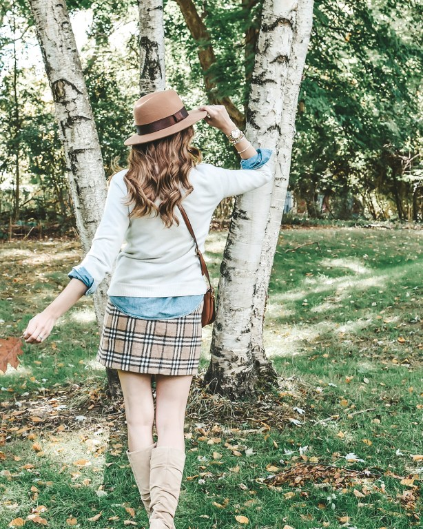 This plaid fall skirt is my new favorite statement piece for the season! I love pairing it with a chambray shirt and cozy sweater for a preppy fall look!