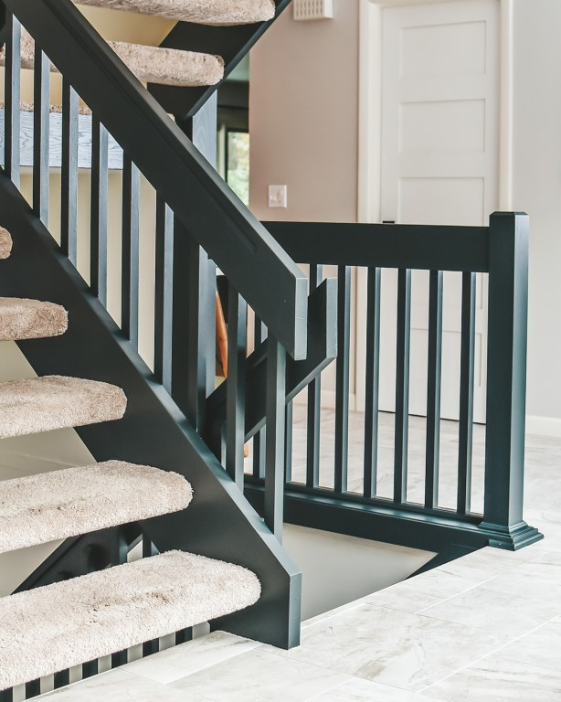 Our latest DIY project is finally ready to reveal! Today I'm sharing how we recently painted our staircase black and we are loving the results!