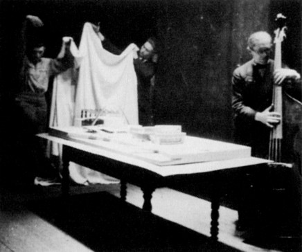Le Corbusier unveiling the model of his proposal for the Palace of the Soviets (1931)