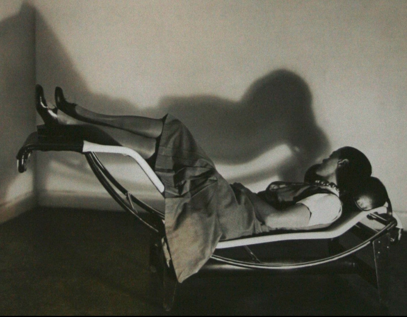 Charlotte Perriand reclining on one of her chairs, 1926