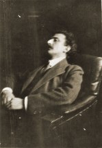 Georg Lukács seated in the darkness of his library (1913)
