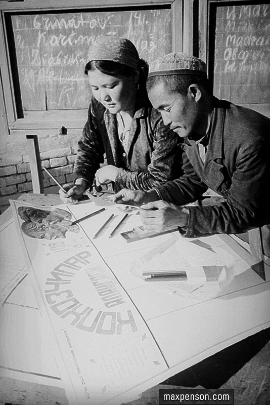 A Man and a woman at work under a wall newspaper. Collective farm