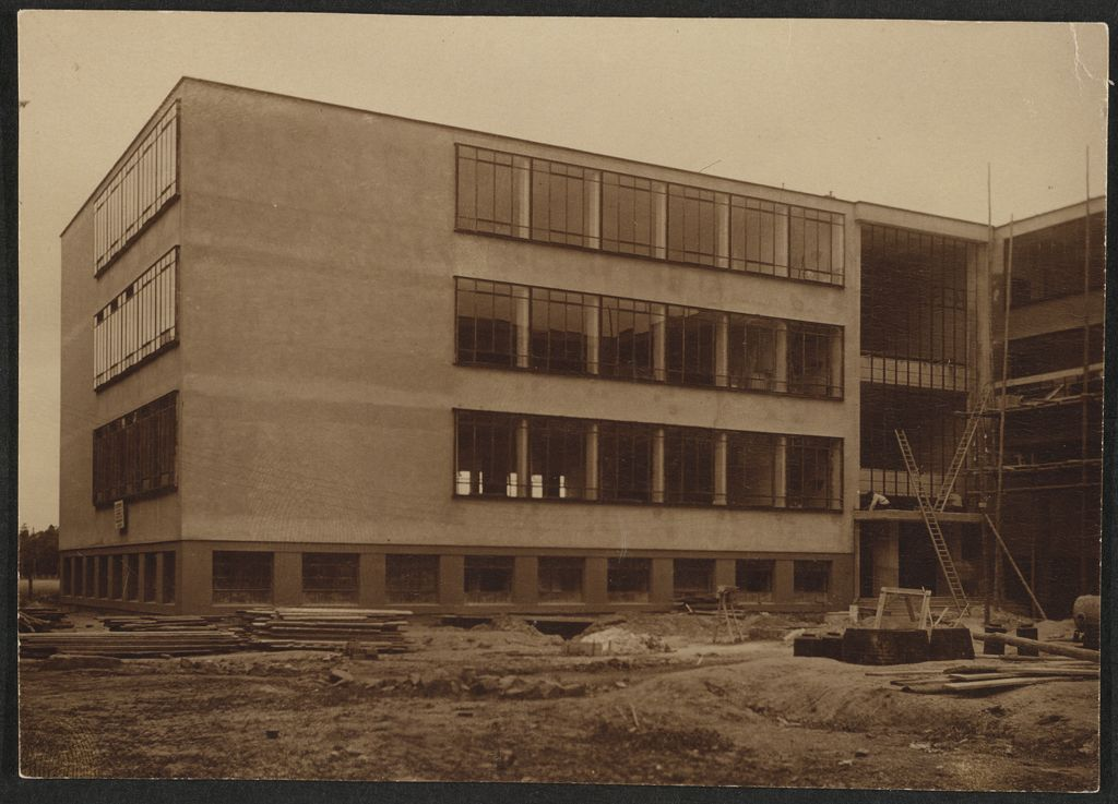 Unidentified photographer Bauhaus Building, Dessau, 1925-1926- North wing (Technical School), under construction, view from southwest [architect- Walter Gropius], c. 1926 Gelatin silver print sheet- 7.8 x 10.9 cm