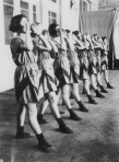"""Varvara Stepanova. Students in sports clothing designed by Stepanova. in performance of An Evening of the Book,. 1924. spelling out """"intermission"""" 1"""
