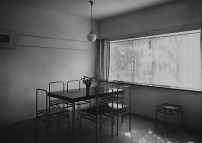 Dr. Lossen & Co. Interior view of the dining room of House 7 showing a table and chairs, Weissenhofsiedlung, Stuttgart, Germany 1927 or later5