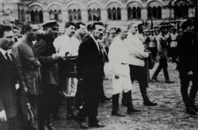Bukharin, Rykov (in dark suit), and Stalin leading the funeral procession for Feliks Dzerzhinskii across Red Square, 1926