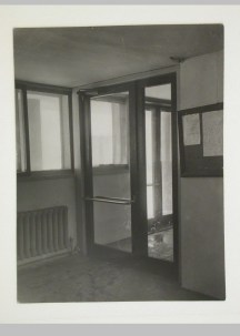 Gruntal, V.G. Interior view of an entrance to the People's Commissariat for Finance (Narkomfin) Apartment Building showing a bulletin board, 25 Novinskii Boulevard, Moscow, after 1930