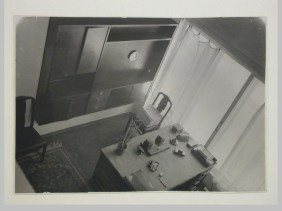 Gruntal, V.G. Interior view of Nikolai Milutin's apartment in the People's Commissariat for Finance (Narkomfin) Apartment Building from the upper level showing a built-in cupboard and a desk, 25 Novinskii Boulevard, Moscow, after 1930