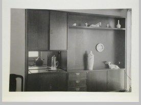 Gruntal, V.G. Interior view of Nikolai Milutin's apartment showing the built-in wall unit in the dining room [?] which opens onto the built-in kitchen, Narkomfin Apartment Building, 25 Novinskii Boulevard, Moscow, after 1930