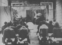 """IN A """"RED WORKERS' CLUB."""" Performance of a play by Mayerhold, in which the political questions of the day are discussed"""