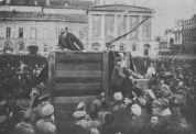 LENIN SPEAKING FROM A PLATFORM ON THE MOSCOW THEATRE SQUARE.