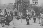 THE GIANT TOYS OF THE COLLECTIVE MAN- figures of Lloyd George, Millerand, Kerenski and Milinkov in front of the Kremlin