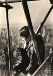 Margaret Bourke-White, 27, stands on the scaffolding enclosing the under-construction Chrysler Building in New York, 1931