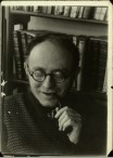 Margaret Bourke-White, Russian Communist Karl B. Radek holding pipe at home (1931)
