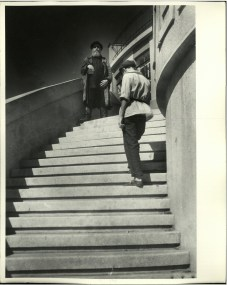 Margaret Bourke-White, Russian men dressed in tunics standing on the steps of a Workers Club (Moscow, 1931)