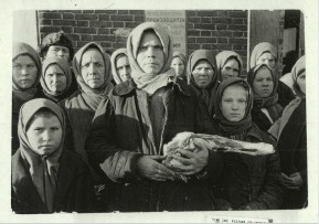 Margaret Bourke-White, Russian woman grimly holding a slab of meat as other peasant women staunchly stand by in Siberia (Magnitogorsk, 1931)