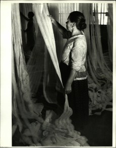 Margaret Bourke-White, Russian worker inspecting lace at factory (Moscow, 1931)