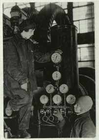 Margaret Bourke-White, Two Russian female workers tending gauges and controls while on duty at an electric power house (Magnitogorsk, 1931)