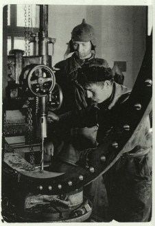 Margaret Bourke-White, Two Russian workers running a drill press in a machine shop (Magnitogorsk, 1931)