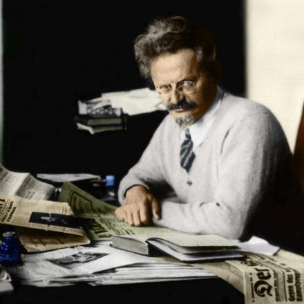leon trotsky reading at his desk, colorized copy