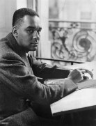 circa-1945-profile-of-african-american-author-richard-wright-seated-at-a-desk-near-a-window