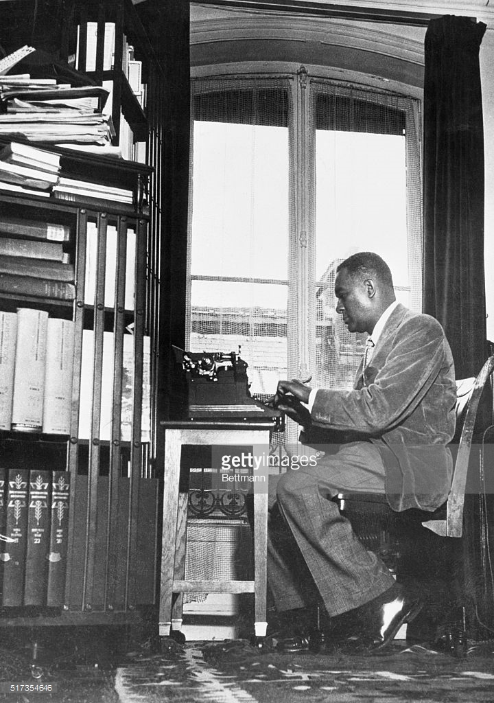 richard-wright-1908-1960-american-writer-shown-at-his-desk-in-his-home-using-his-old-typewriter-undated-b_w-photo