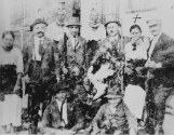 hunting-party-in-bukovina-1912-leon-reich-second-from-left-wilhelm-holding-gun-at-his-fathers-side-robert-reich-seated-right-foreground