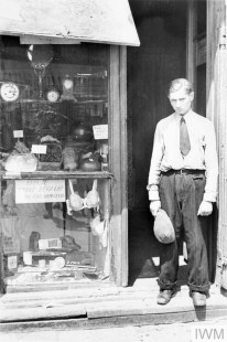 A young man in the doorway of a shop in the ghetto