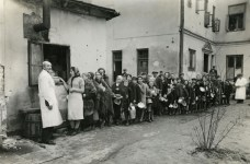 Jews are seen lining up in the Warsaw Ghetto during World War II