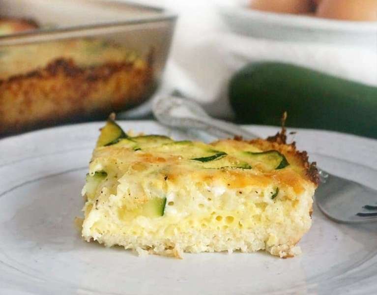 This Keto Quiche with a Cauliflower Crust is a delicious Keto dish that is low carb and gluten-free as well! Filled with zucchini and mozzarella, it is flavorful and easy to make ahead for on-the-go breakfasts or lunches.