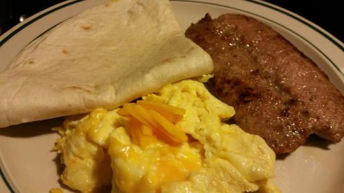 Scrambled Cheese Eggs with pan-fried Italian Sausage and a warm tortilla