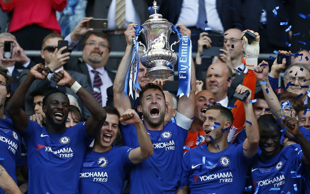 LONDON, ENGLAND - MAY 19: Chelsea's Gary Cahill lifts the trophy with team mates after the Emirates FA Cup Final match between Chelsea and Manchester United at Wembley Stadium on May 19, 2018 in London, England. (Photo by Craig Mercer - CameraSport via Getty Images)