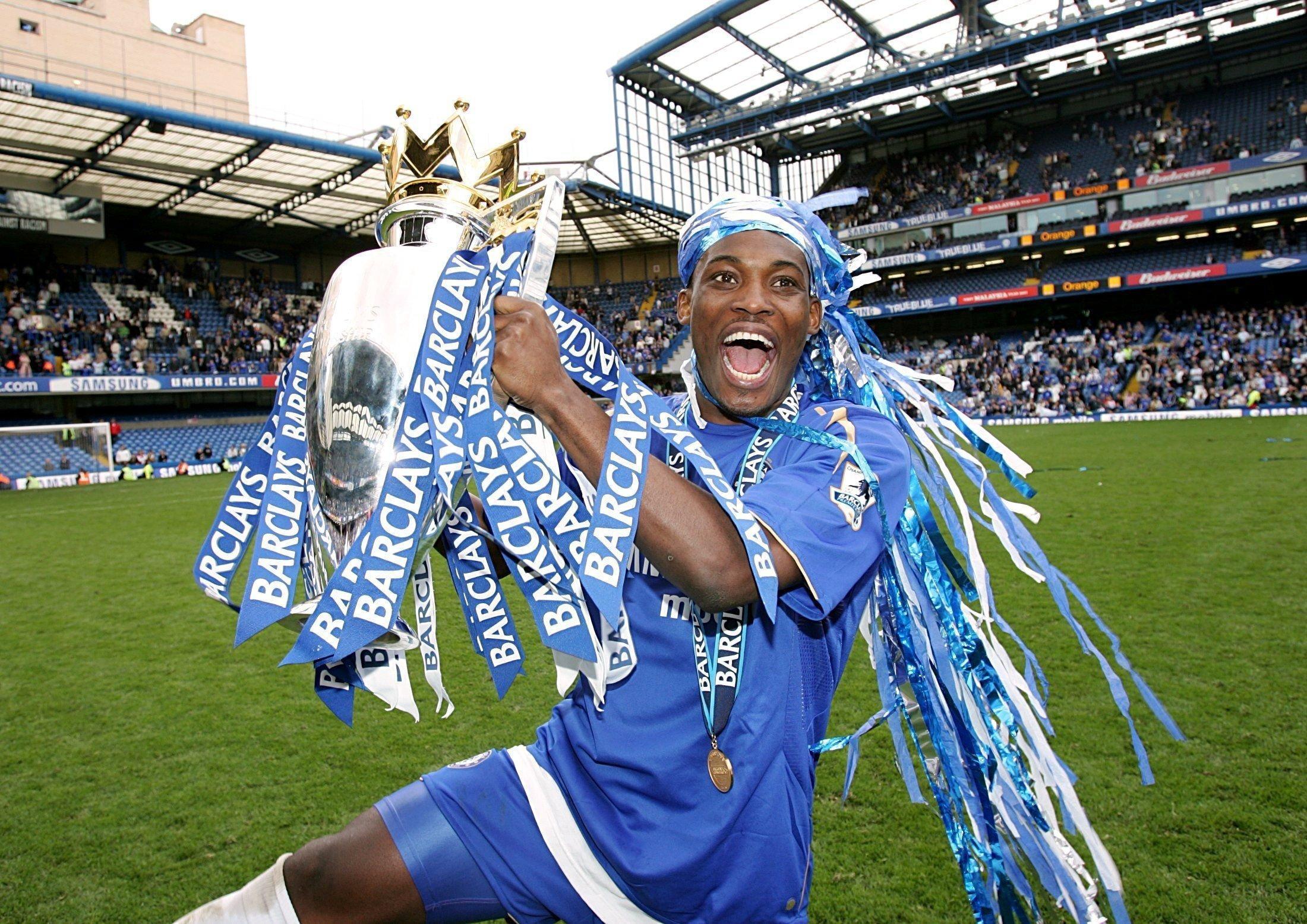 Michael Essien celebrating winning the Premier League