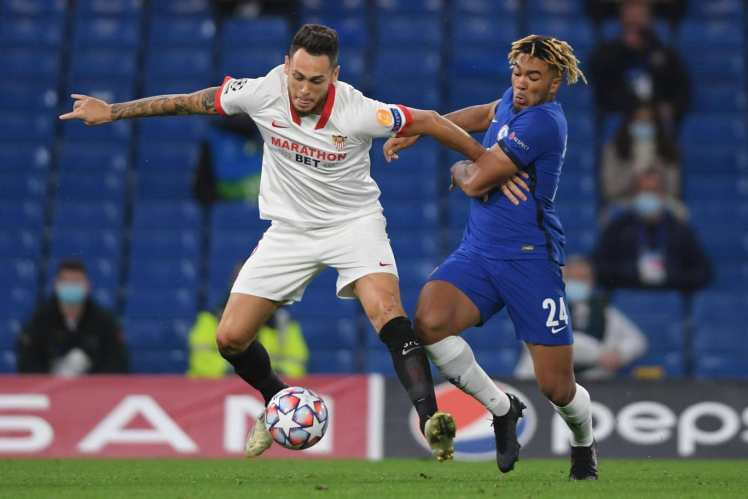 Chelsea 0-0 Sevilla - Reece James tussles with Lucas Ocampos.