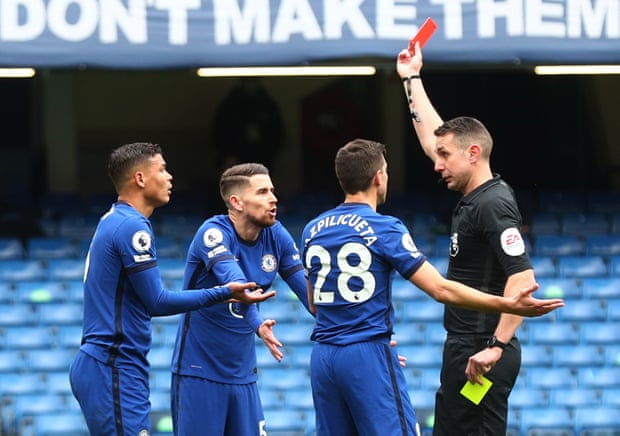 LONDON, ENGLAND - APRIL 03: Thiago Silva of Chelsea and teammates Jorginho and Cesar Azpilicueta argue with match referee David Coote after he is shown a red card during the Premier League match between Chelsea and West Bromwich Albion at Stamford Bridge on April 03, 2021 in London, England. Sporting stadiums around the UK remain under strict restrictions due to the Coronavirus Pandemic as Government social distancing laws prohibit fans inside venues resulting in games being played behind closed doors. (Photo by Clive Rose/Getty Images)