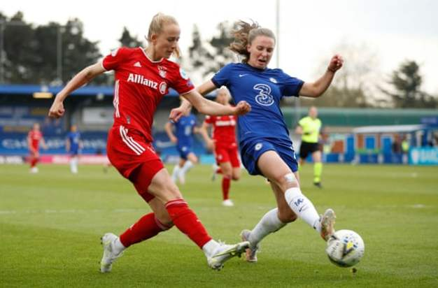 Niamh Charles tussles with Lea Schüller on the wing.